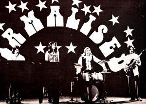 Toivo Kurmet, Melike Amjärv, Ülo Kurmet ja Paavo Soots Virmaliste vinüülplaadi kaanel. Album on välja antud 1980. aastal Stockholmis.